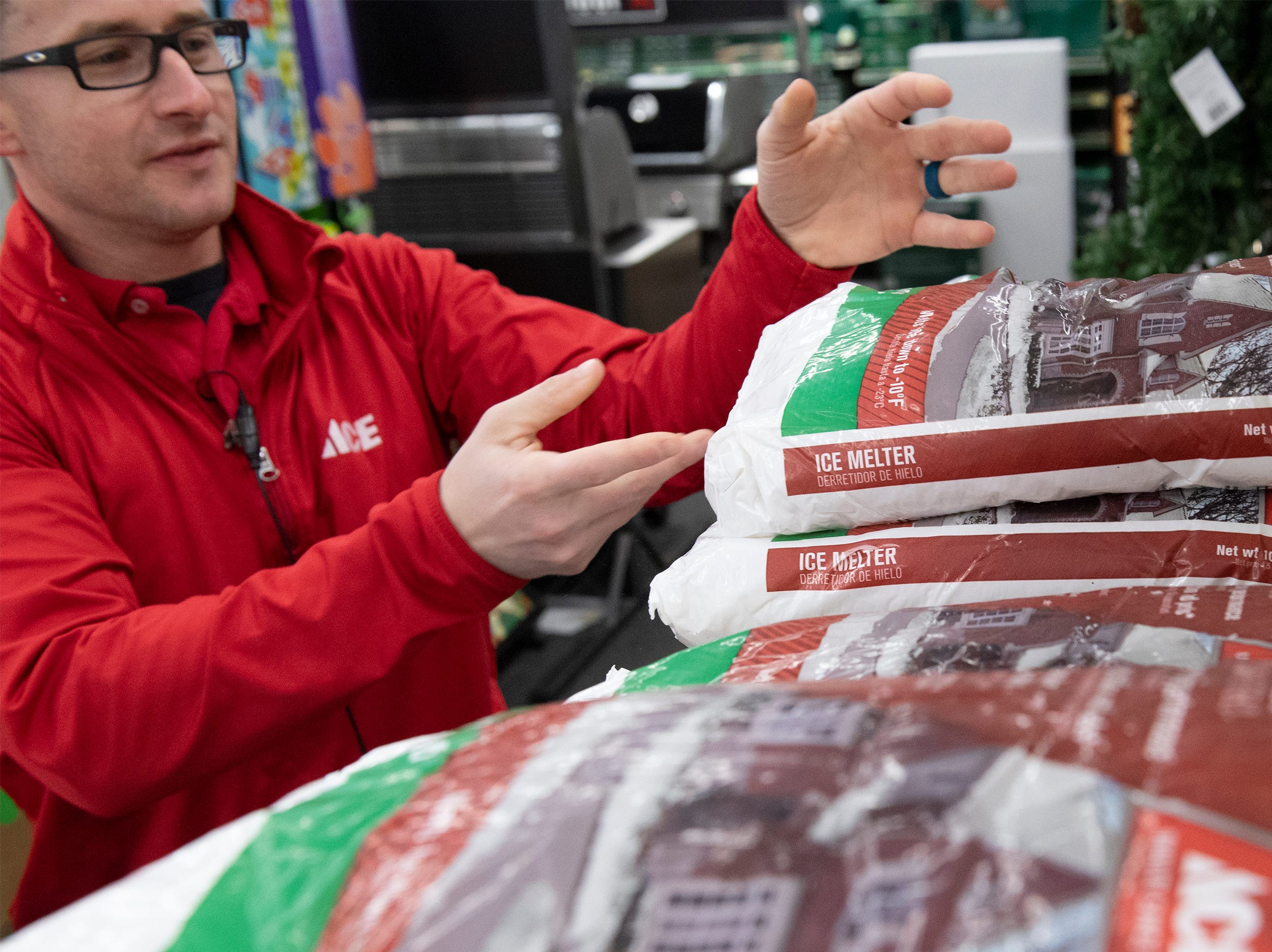 Store Manager Jeff Knight shelves small bags of ice melt which arrived with a delivery at Classic Ace Hardware in Greenville Friday, Dec. 07, 2018. According to Knight, they increased their order of snow related supplies for this weekend.