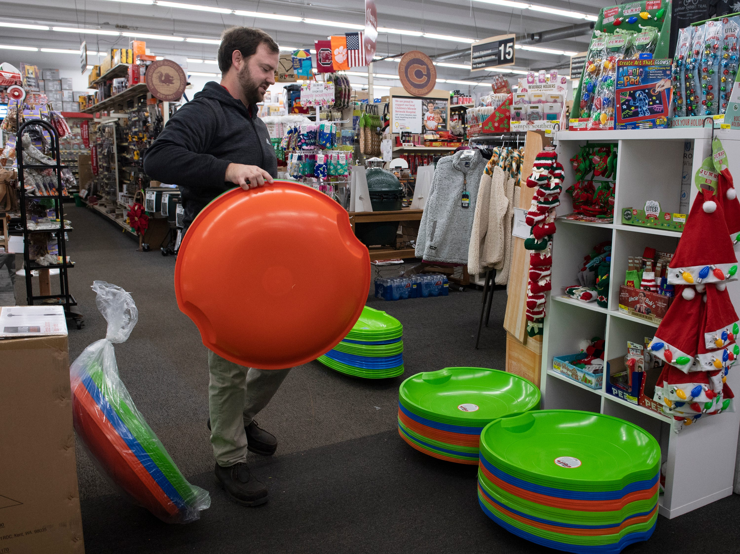"Zack Melton unpacks ""Flexible Flyer"" sleds at Classic Ace Hardware in Greenville early Friday, Dec. 07, 2018."