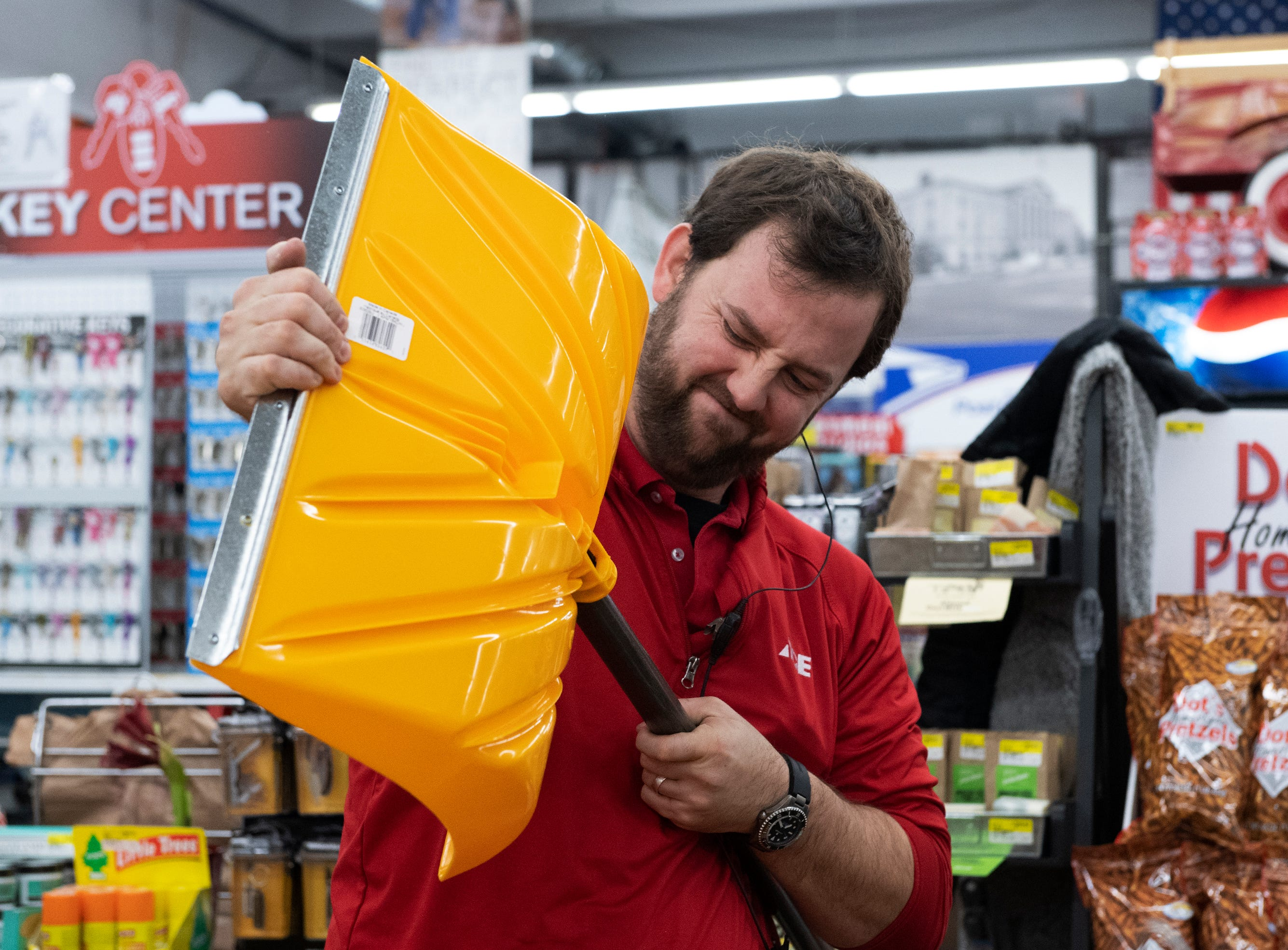 Zack Melton assembles snow shovels for sale before Classic Ace Hardware in Greenville opens Friday Friday, Dec. 07, 2018.