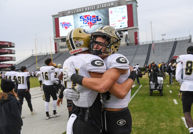 Greer quarterback Matthew Huff (17), left, and Ethan Alexander (14) hug after their loss to Myrtle Beach in the class AAAA state finals Friday, December 5, 2018 at Williams Brice Stadium in Columbia.