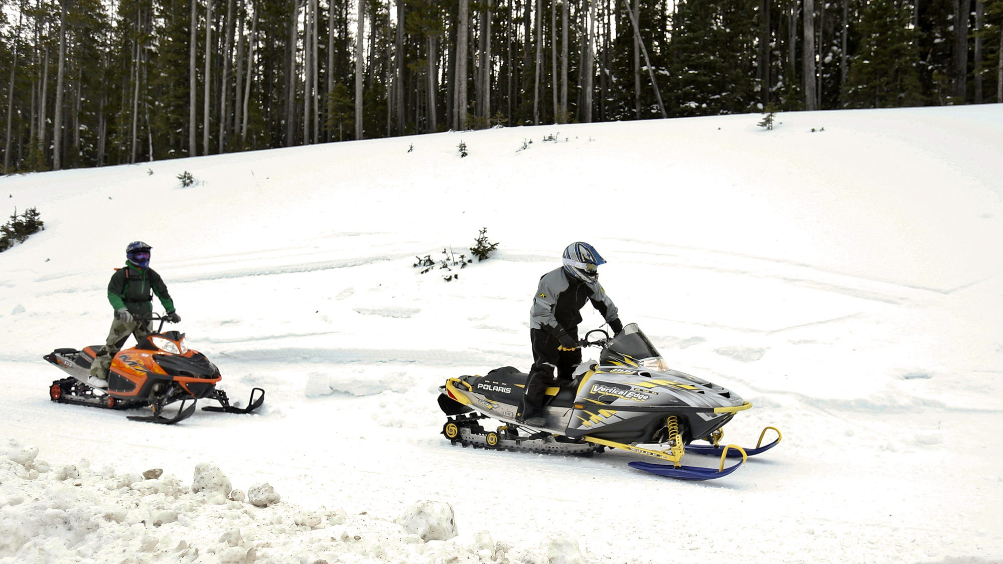 Snowmobilers take advantage of new snow in the Little Belt Mountains.