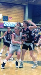 Ali Kronebusch defends against Chinook during Class B girls' basketball play about 20 years ago.