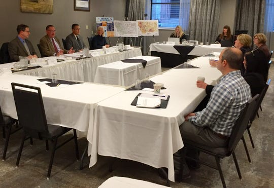 State officials, right, listen Dec. 7 to recommendations from a panel assessing Montana's efforts to end impaired driving.
