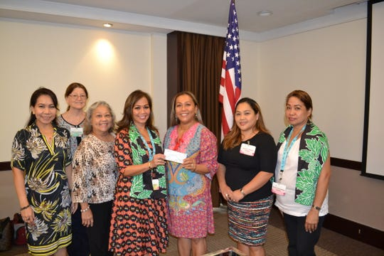 Guam Women's Club board presented a $500 check to Angel Tree Project/Prison Fellowship nonprofit organization at their general membership meeting held Nov. 16 at the Sheraton Laguna Guam Resort. Pictured from left: Cari Nakagawa, GWC secretary; Mary Lou Wheeler, GWC vice president; Loling Field GWC treasurer; Caroline H. Sablan, GWC president; Vangie Cabacar, Angel Tree Project/Prison Fellowship executive director; Angie Gibbons, GWC member at large; Maricor Gerstenlauer, GWC member at large.