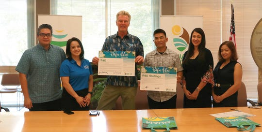 IT&E and IP&E representatives, joined by Guam Visitors Bureau Vice President Antonio Muña Jr., take the Håfa Pledge on Nov. 15. From left: Antonio Muña Jr., GVB vice president; Angela Rosario, IT&E director of product and marketing; Jim Oehlerking, IT&E chief executive officer; Brian Bamba, IP&E managing director; Camille Denight, IP&E marketing manager; Daphne Leon Guerrero, IP&E human resources manager.