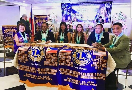 The Guam Latte Stone Lions Club and the Subic Bay Centennial Lions Club on  Nov. 13 in Buena Casa Hotel in Subic Bay Metropolitan Authority. Pictured from left: Anabelle Dancel, Art Navarro, GLSLC President Ria McNeil, SBCLC President Tess Endaya, Remigio Pangan, Anacleto Nazarenos
