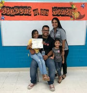 On Nov. 8 Guåhan Academy Charter School honored their October Student of the Month at their campus. Honoree from third grade was Ryu Janet Sigrah Mori. Pictured from left: Ryu Janet, T'Nel Mori, father; Dora Mori, mother and   Luna Nelsina, sister.
