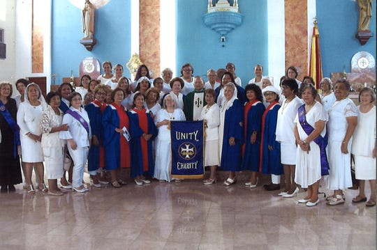 Members of the Catholic Daughters of the Americas from local courts Maria Rainan Y Familia from Tamuning and Our Lady of Camarin of Hagatna are shown at the Dulce Nombre de Maria Cathedral Basilica in Hagatna following their attendance at the 9:30 a.m. mass as part of the court's planned activities in commemoration of the 113 year anniversary when the order was first formed in Utica, New York in 1903. Monsignor Brigido Arroyo served as the main celebrant of the mass. Governor Eddie Calvo designated Oct. 21, 2018 as Catholic Daughter Day.