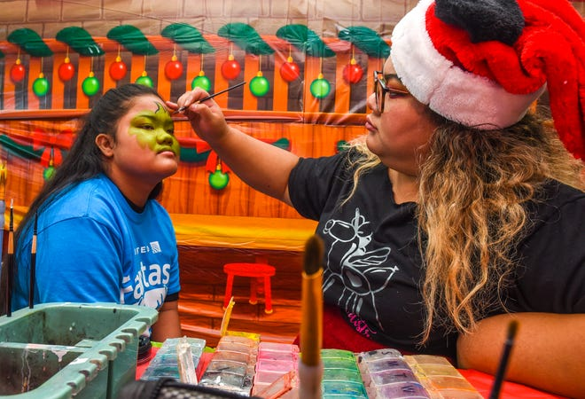 Thirty-three Guam Special Olympians, and their guests, participated in United Airlines' Fantasy Flight to the North Pole at the A.B. Won Pat International Airport on Friday, Dec. 7, 2018. The passengers were presented with an experience to enjoy live entertainment, food, games, holiday cookie decorating and face paintings after a make-believe flight to visit Santa Claus and his helpers. The event was the air carrier's fifth consecutive year of sharing holiday cheer with a group of the island's deserving children. This year, the airline's Guam hub was joined by 15 other United destinations around the globe in celebrating the holiday event.