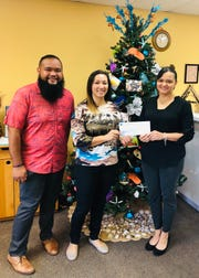 The Guam Premier Outlets donated $300 to Manelu for its annual Breakfast with Santa event on Dec. 5. Pictured from left: Edimund Wengu, project director for the Micronesian Resource Center, Samantha Taitano, Manelu executive director and Suzanne Perez, GPO Director of Marketing and Operations.