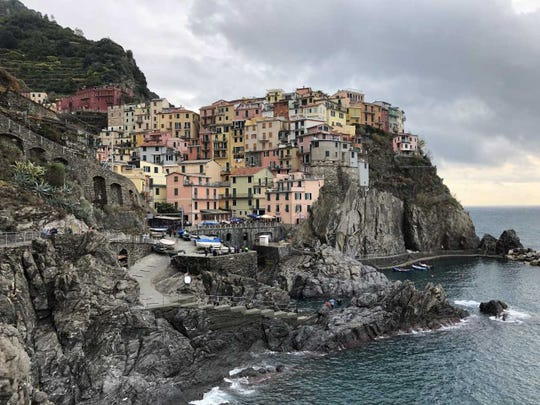 "Manarola on the Cinque Terre (""five lands"") on the rugged Italian Riviera once was a sleepy fishing village. Today it draws (according to ABC) 2.4 million visitors a year. We visited during the off-season. We won."