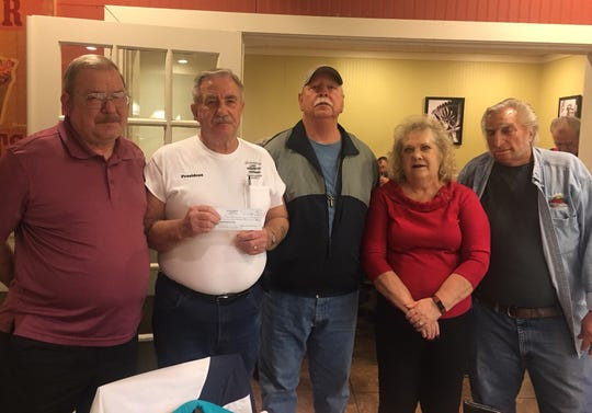 Klassix Kruisers members, from left, Steve Hayes, Danny Laughary, Danny Blanford, Bernice Schriber and Kenny Laughary present the Henderson Goodfellows with a check for $1,500 last week.