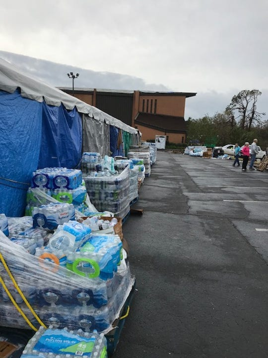 Disaster relief supplies stored in the St. Andrews Church parking lot under tarps. The church building lost its roof during Hurricane Michael's early October landfall in the Florida panhandle.