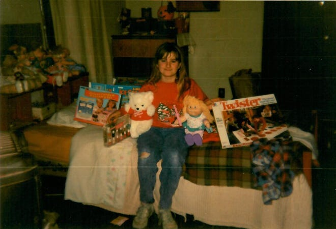 Susan Bryant, who benefited from the Goodfellows program several times as a child, poses with her Christmas gifts in this family photo. She was 10 or 11 at the time.