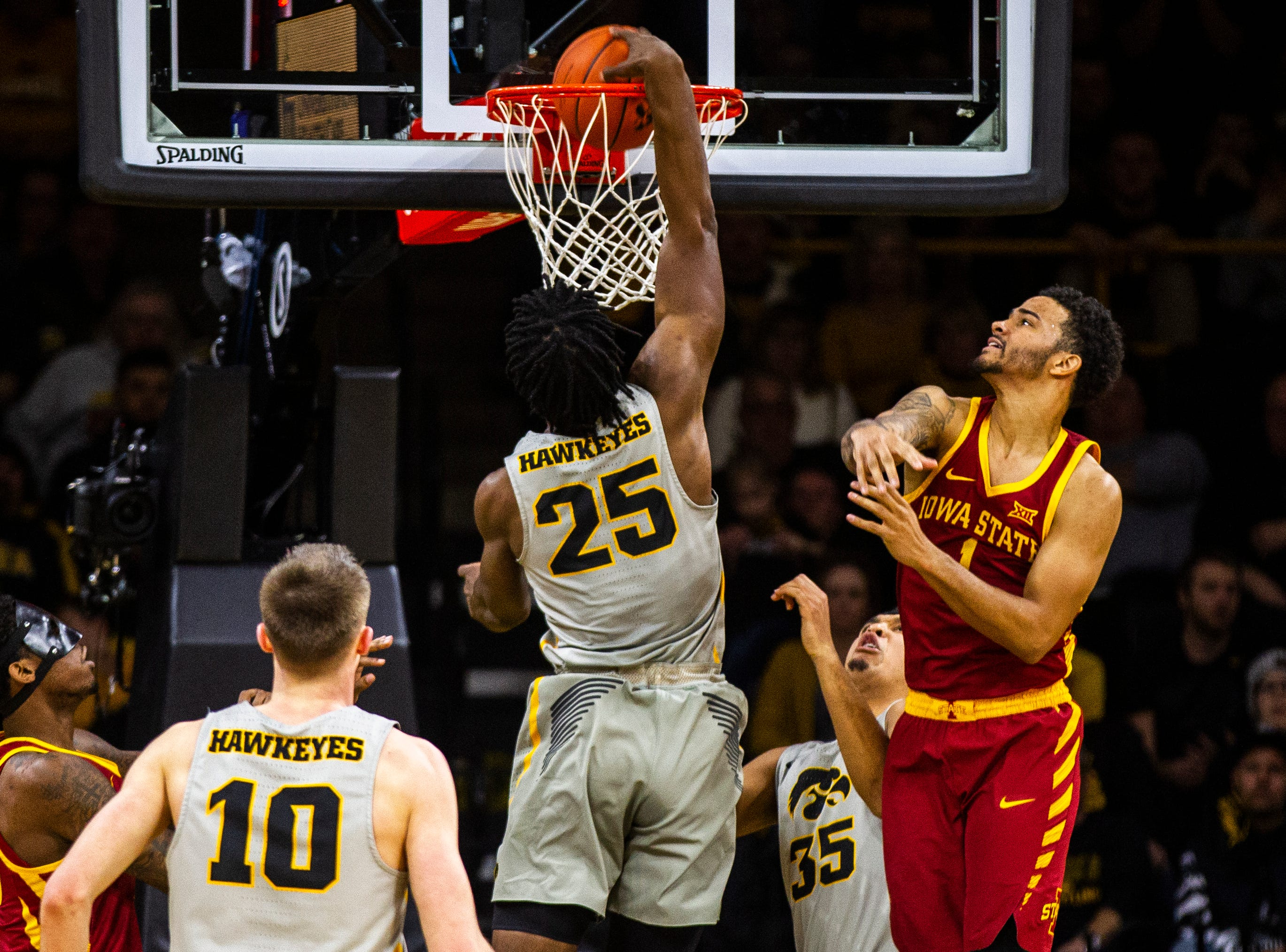 Iowa forward Tyler Cook (25) dunks during a NCAA Cy-Hawk series men's basketball game on Thursday, Dec. 6, 2018, at Carver-Hawkeye Arena in Iowa City.