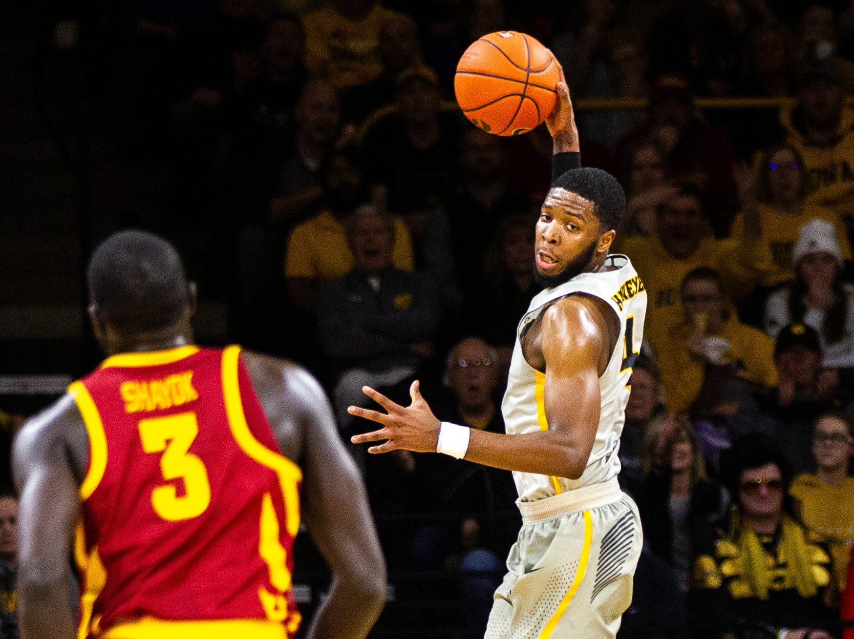 Iowa guard Isaiah Moss (4) grabs a rebound during a NCAA Cy-Hawk series men's basketball game on Thursday, Dec. 6, 2018, at Carver-Hawkeye Arena in Iowa City.