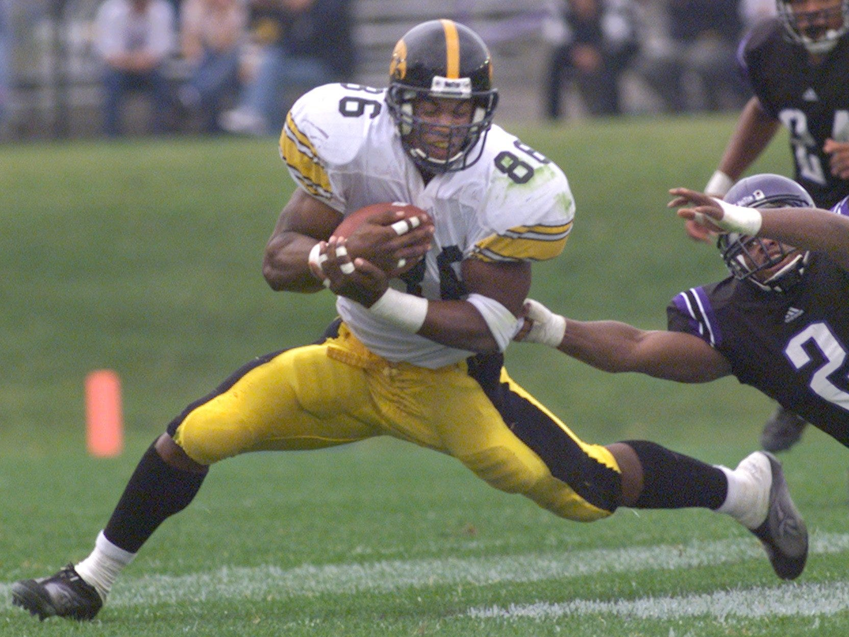 From 1999: Iowa tight end Austin Wheatley catches a pass from Randy Reiners while Kevin Bentley defends for Northwestern.
