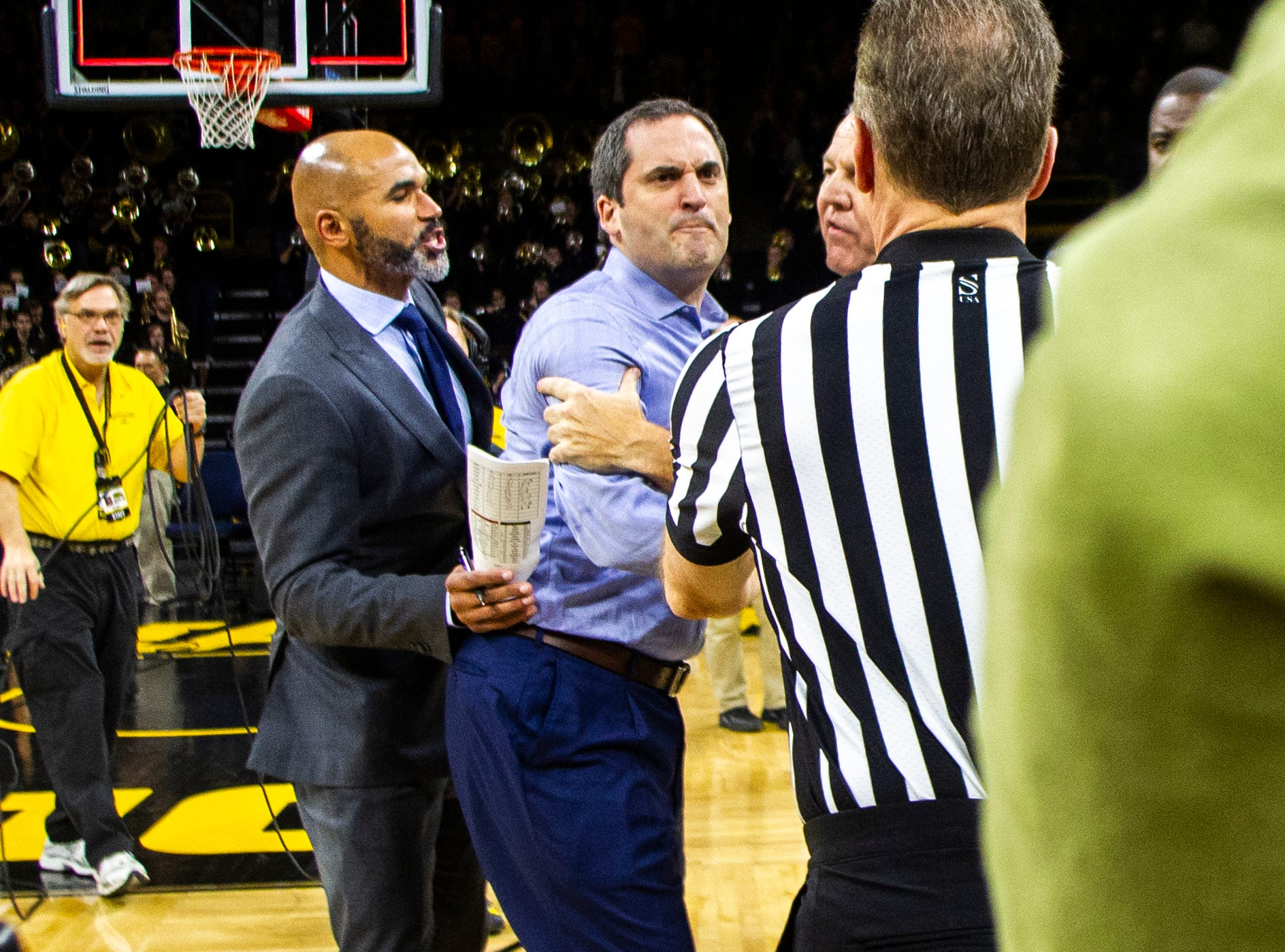 Iowa State head coach Steve Prohm gets held back by officials after the buzzer a NCAA Cy-Hawk series men's basketball game on Thursday, Dec. 6, 2018, at Carver-Hawkeye Arena in Iowa City.
