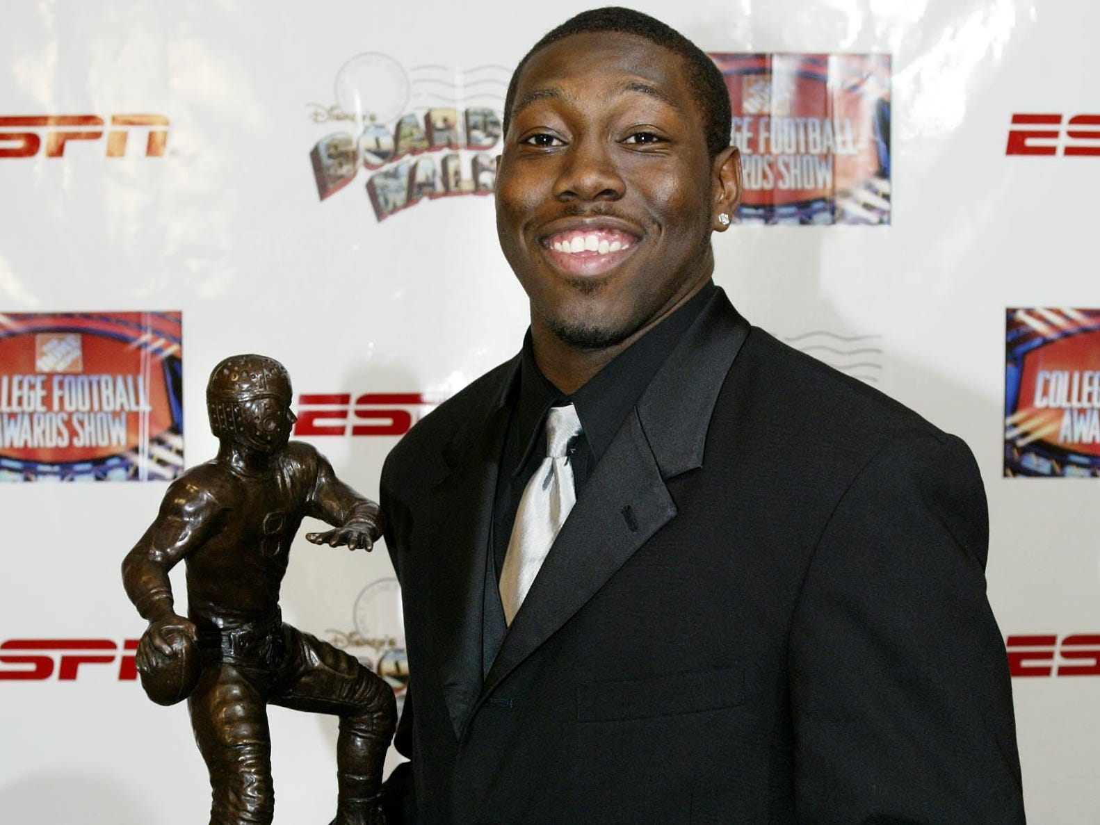 From 2002: Iowa quarterback Brad Banks smiles while holding his award after winning the Davey O'Brien National Quarterback Award at the Home Depot College Football Awards on Thursday, Dec.12, 2002 at the Atlantic Hall at the Walt Disney World Resort in Lake Buena Vista, Florida.