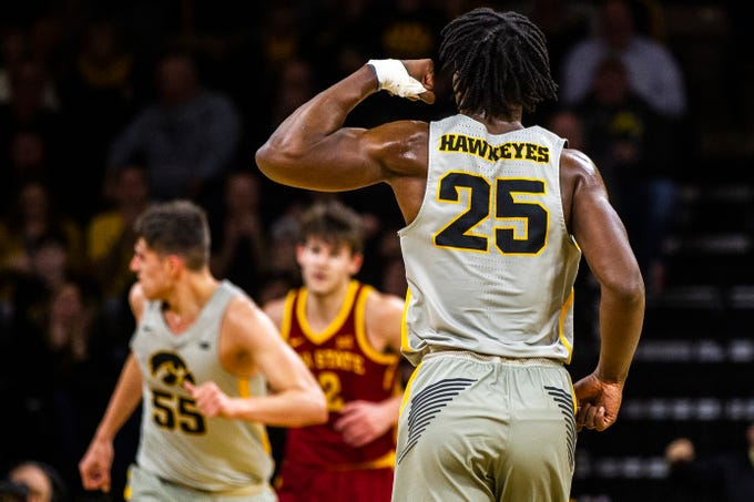 Iowa forward Tyler Cook (25) flexes after a dunk during a NCAA Cy-Hawk series men's basketball game on Thursday, Dec. 6, 2018, at Carver-Hawkeye Arena in Iowa City.