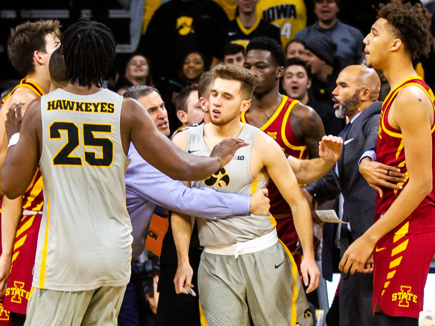 Iowa State head coach Steve Prohm grabs Iowa guard Jordan Bohannon (3) after the buzzer of a NCAA Cy-Hawk series men's basketball game on Thursday, Dec. 6, 2018, at Carver-Hawkeye Arena in Iowa City.