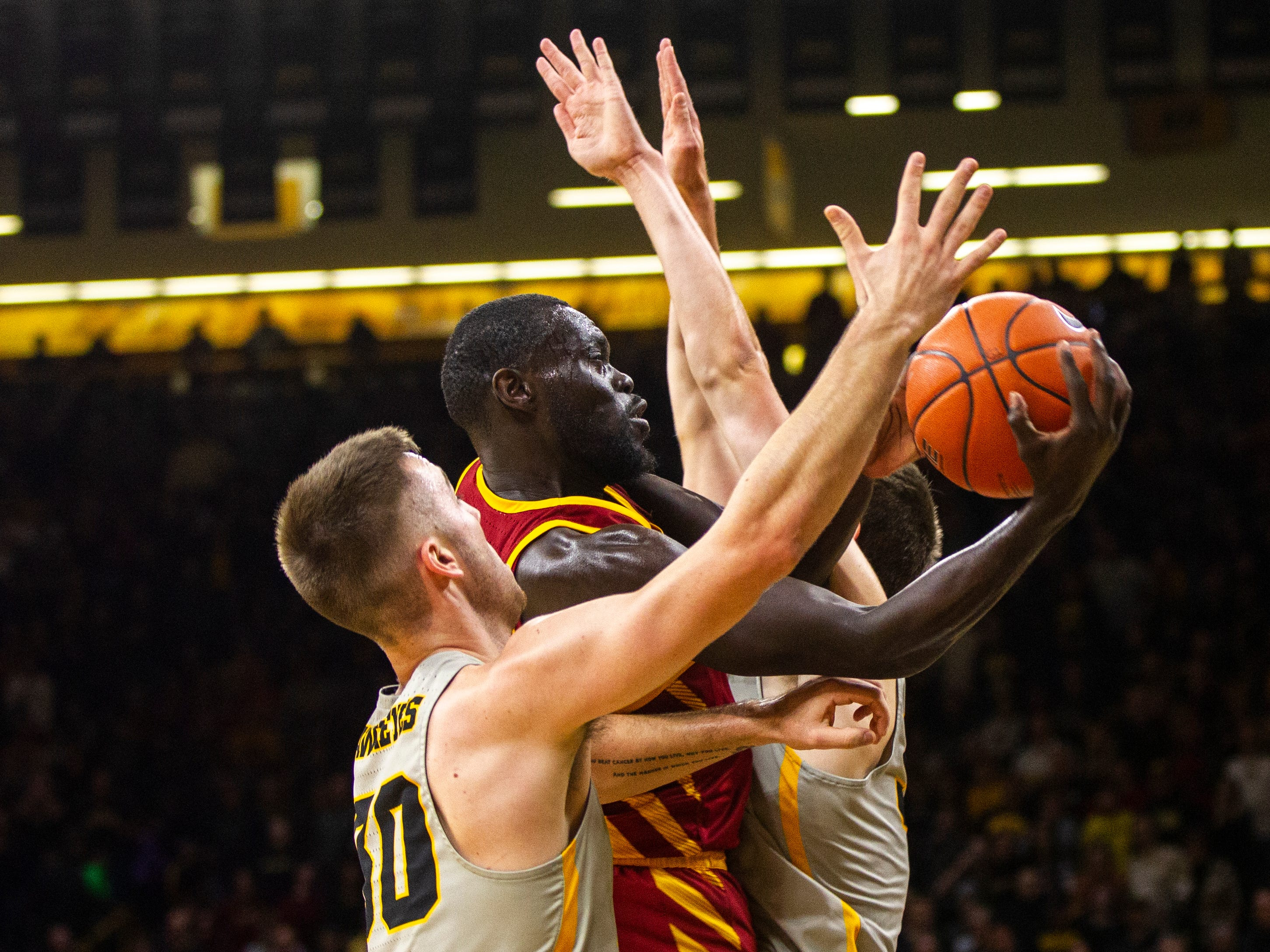 Iowa State guard Marial Shayok (3) drives to the hoop while being defended by Iowa guard Connor McCaffery (30) during a NCAA Cy-Hawk series men's basketball game on Thursday, Dec. 6, 2018, at Carver-Hawkeye Arena in Iowa City.