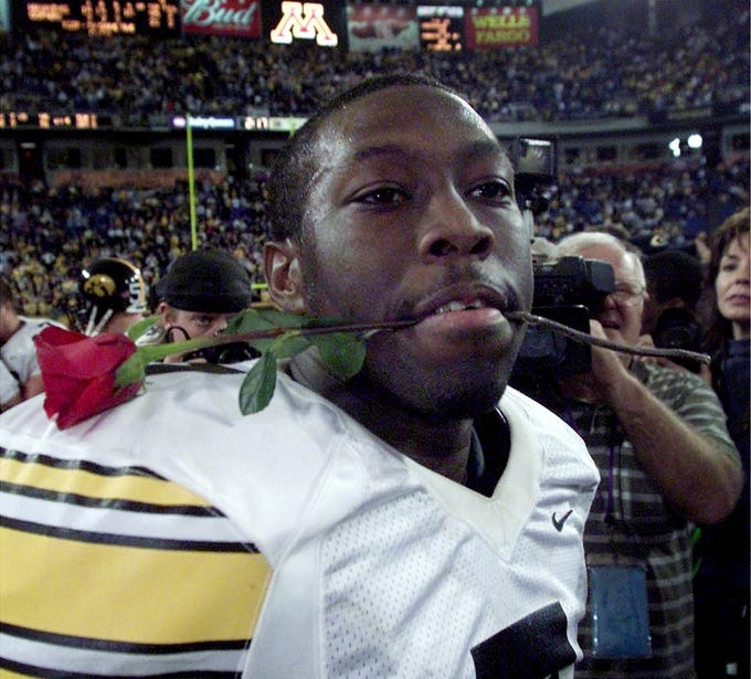 From 2002: Iowa quarterback Brad Banks (7) with a rose after the Hawkeyes beat Minnesota, 45-21, at the Metrodome in Minneapolis.