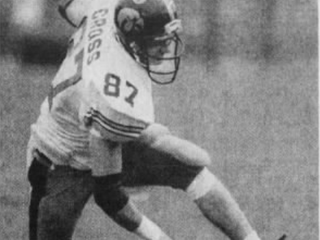 From 1991: Iowa Hawkeyes tight end Alan Cross runs over Purdue's Jimmy Young.