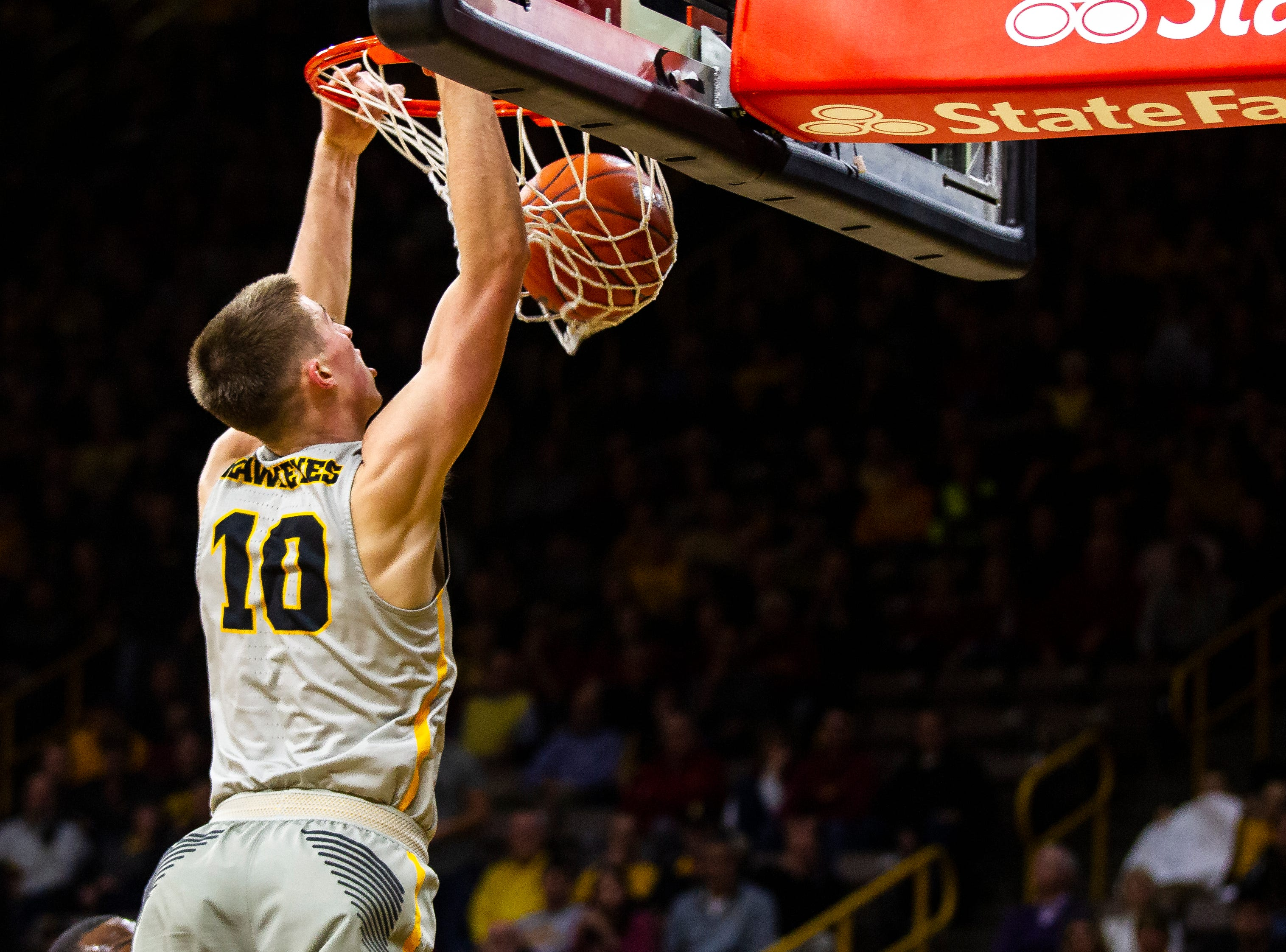 Iowa guard Joe Wieskamp (10) dunks during a NCAA Cy-Hawk series men's basketball game on Thursday, Dec. 6, 2018, at Carver-Hawkeye Arena in Iowa City.