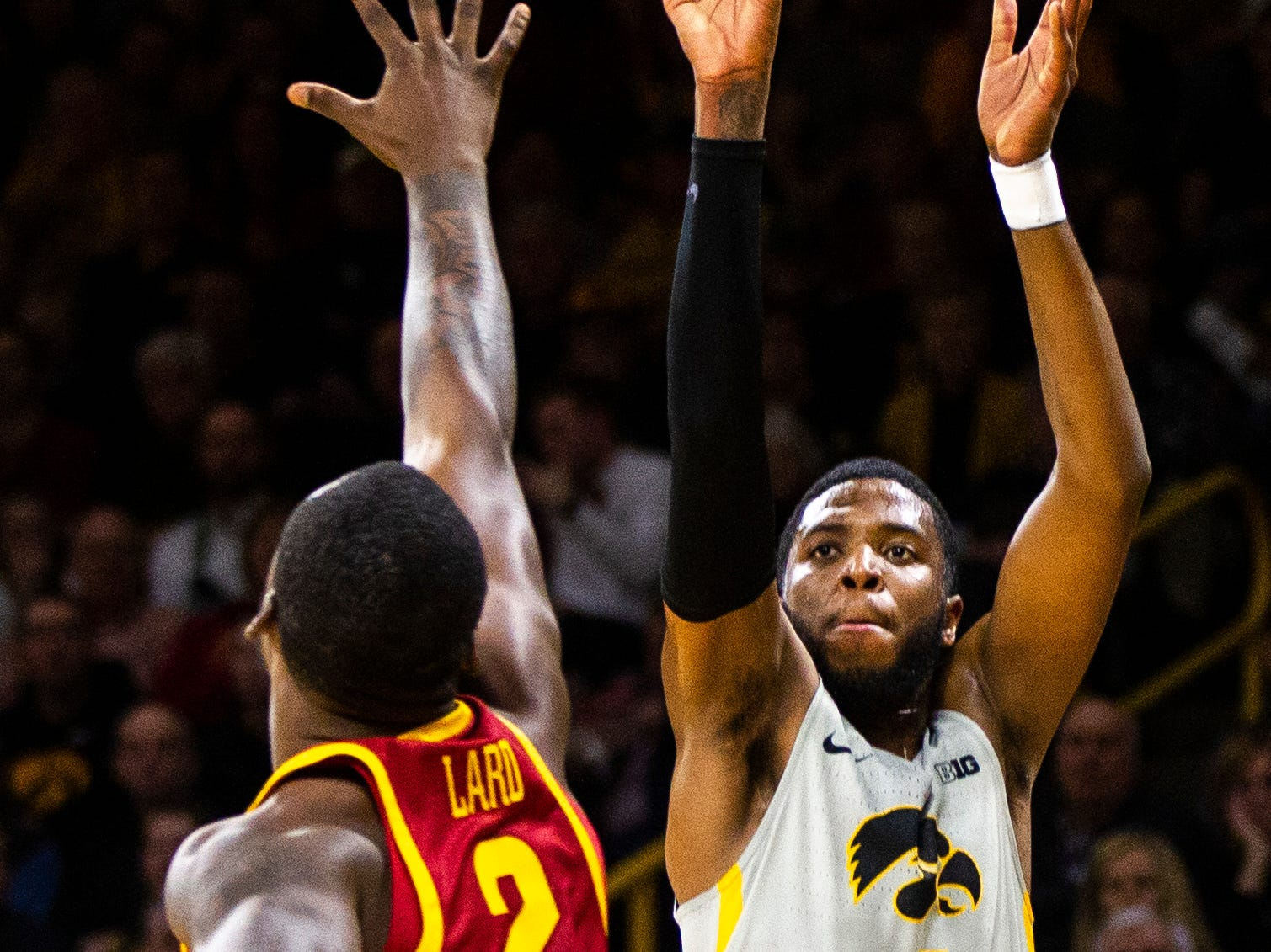 Iowa guard Isaiah Moss (4) shoots a 3-point basket over Iowa State forward Cameron Lard (2) during a NCAA Cy-Hawk series men's basketball game on Thursday, Dec. 6, 2018, at Carver-Hawkeye Arena in Iowa City.