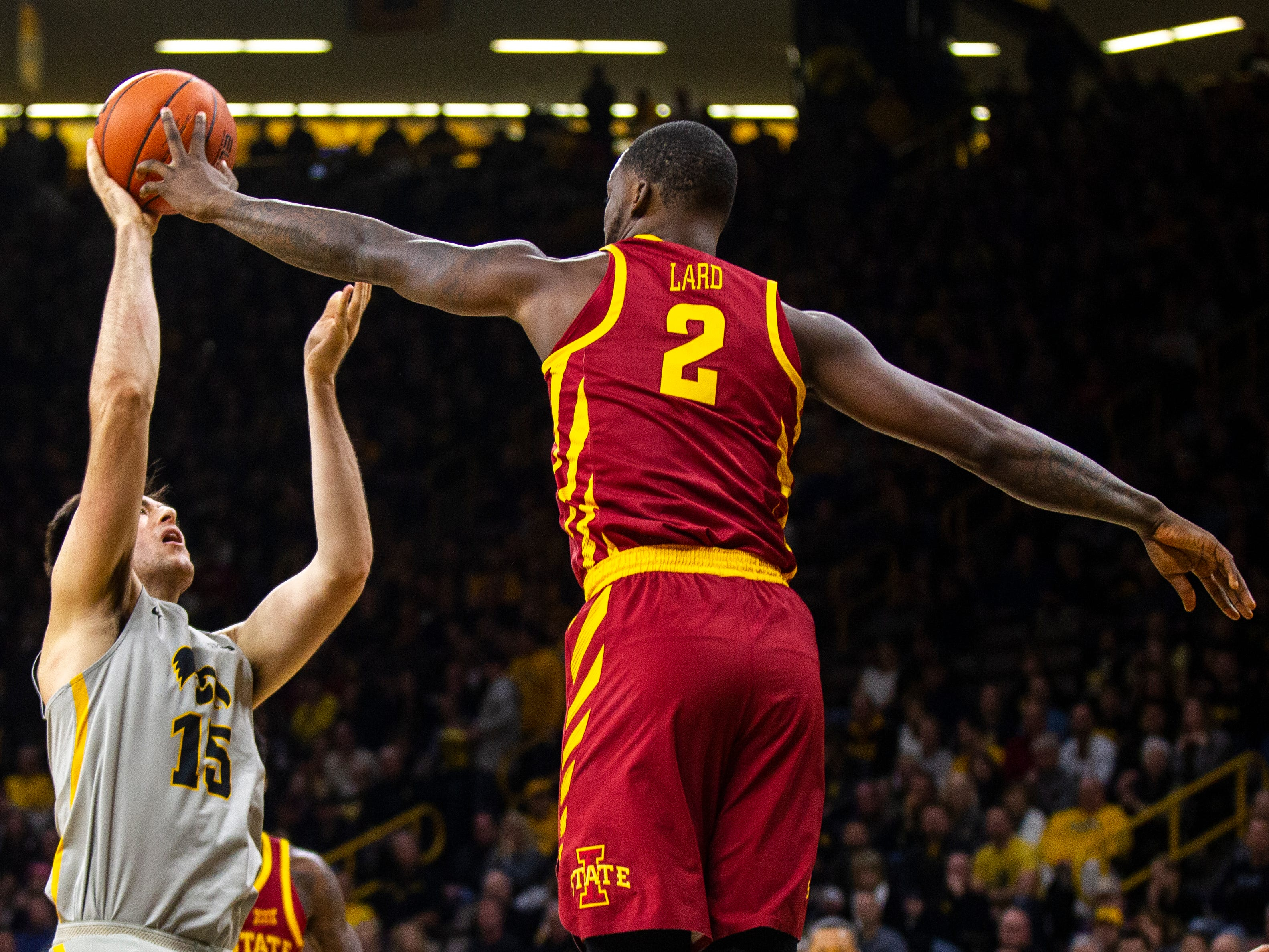 Iowa State forward Cameron Lard (2) blocks Iowa forward Ryan Kriener's shot during a NCAA Cy-Hawk series men's basketball game on Thursday, Dec. 6, 2018, at Carver-Hawkeye Arena in Iowa City.