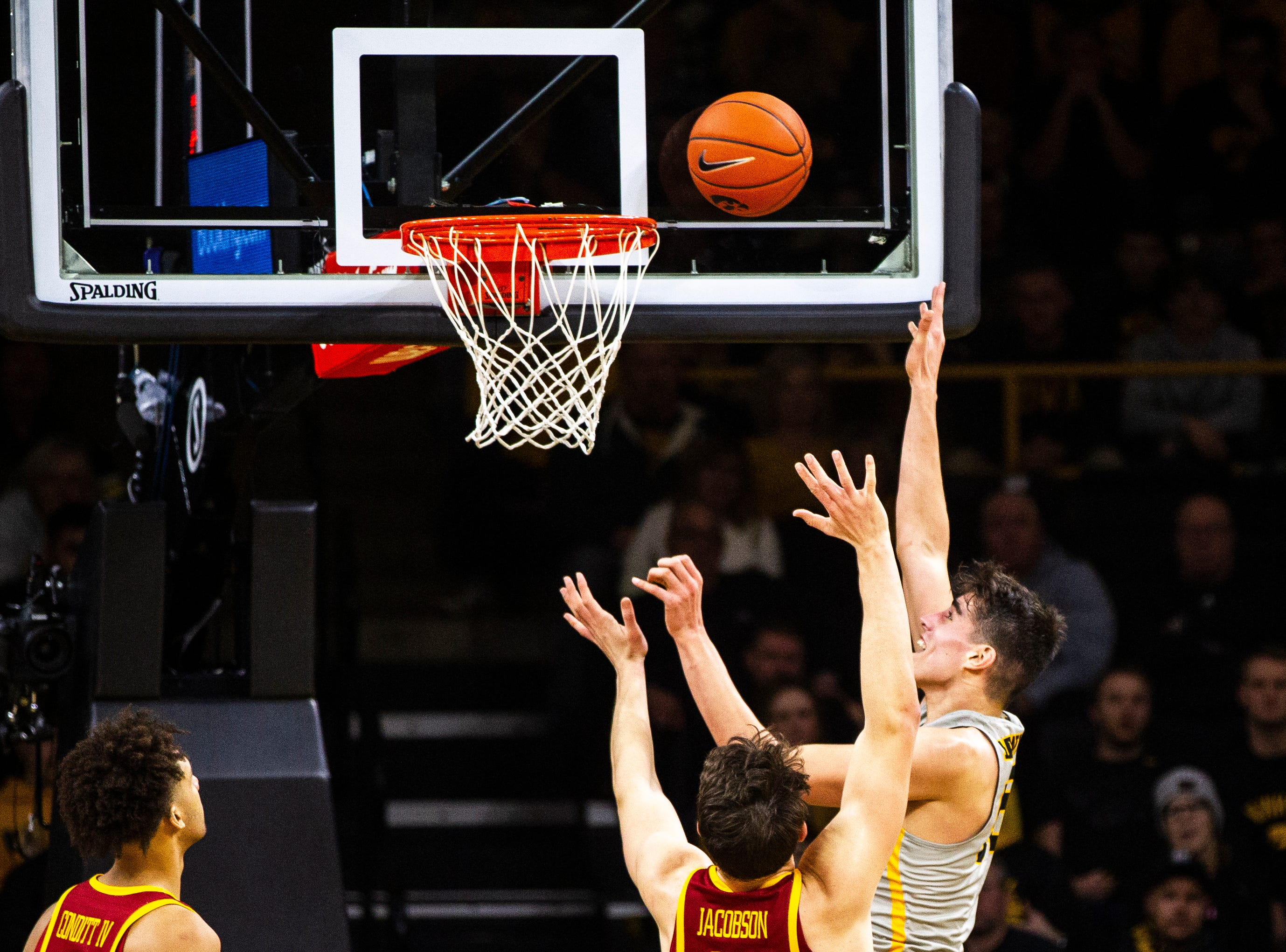 Iowa forward Luka Garza (55) attempts a basket during a NCAA Cy-Hawk series men's basketball game on Thursday, Dec. 6, 2018, at Carver-Hawkeye Arena in Iowa City.