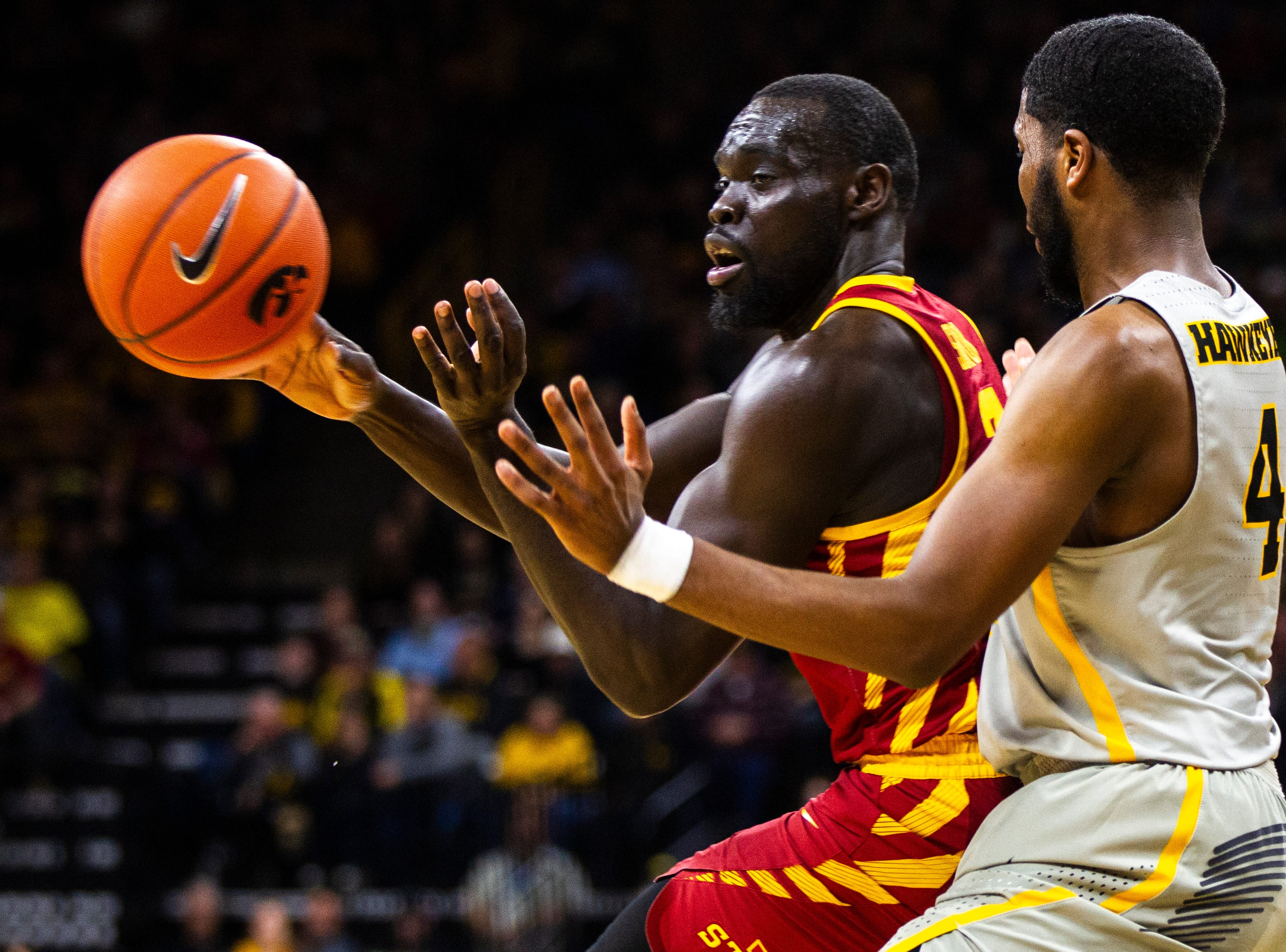 Iowa State guard Marial Shayok (3) passes while being defended by Iowa guard Isaiah Moss (4) during a NCAA Cy-Hawk series men's basketball game on Thursday, Dec. 6, 2018, at Carver-Hawkeye Arena in Iowa City.