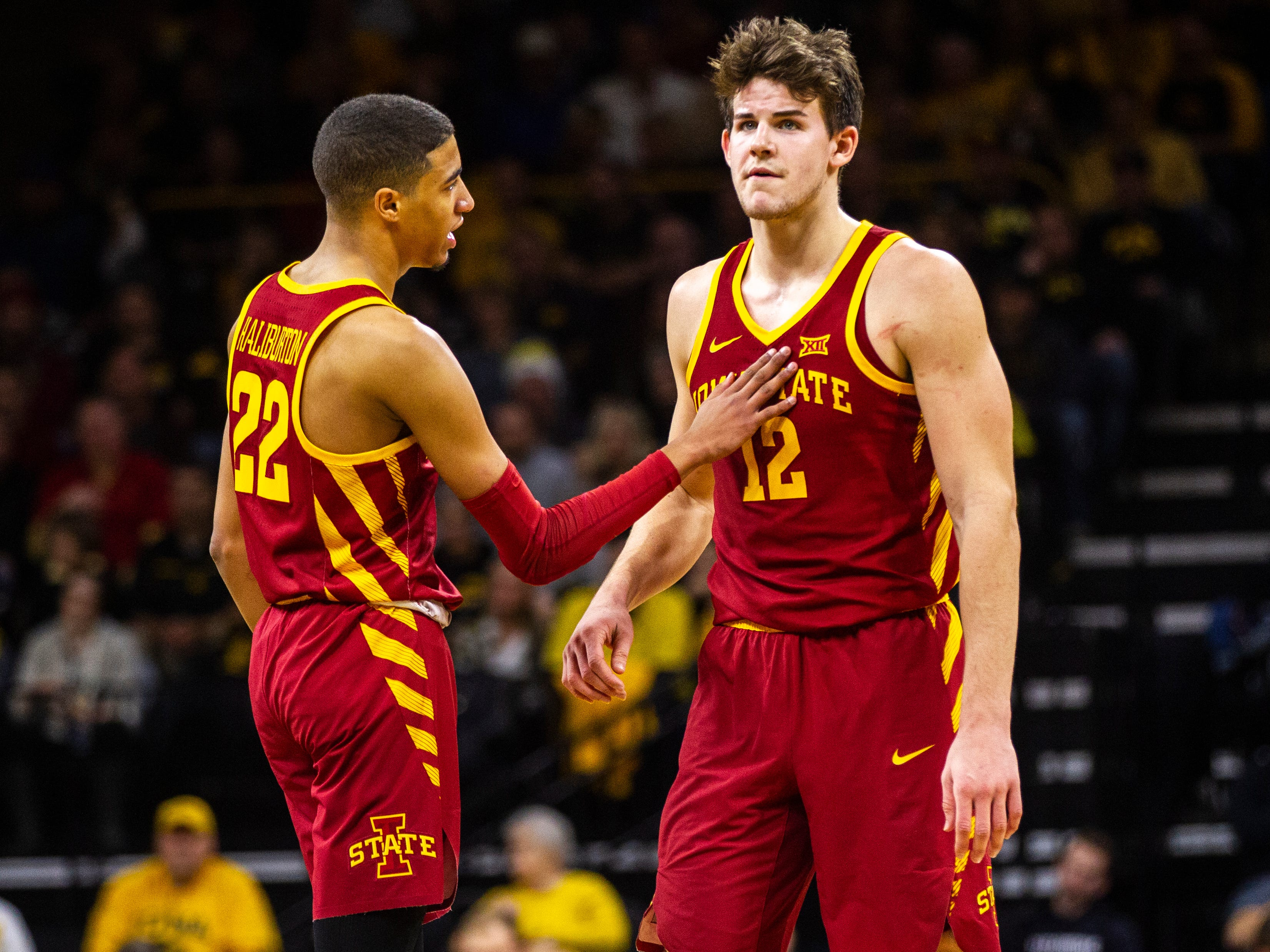 Iowa State guard Tyrese Haliburton (22) pats Iowa State forward Michael Jacobson (12) on the chest during a NCAA Cy-Hawk series men's basketball game on Thursday, Dec. 6, 2018, at Carver-Hawkeye Arena in Iowa City.