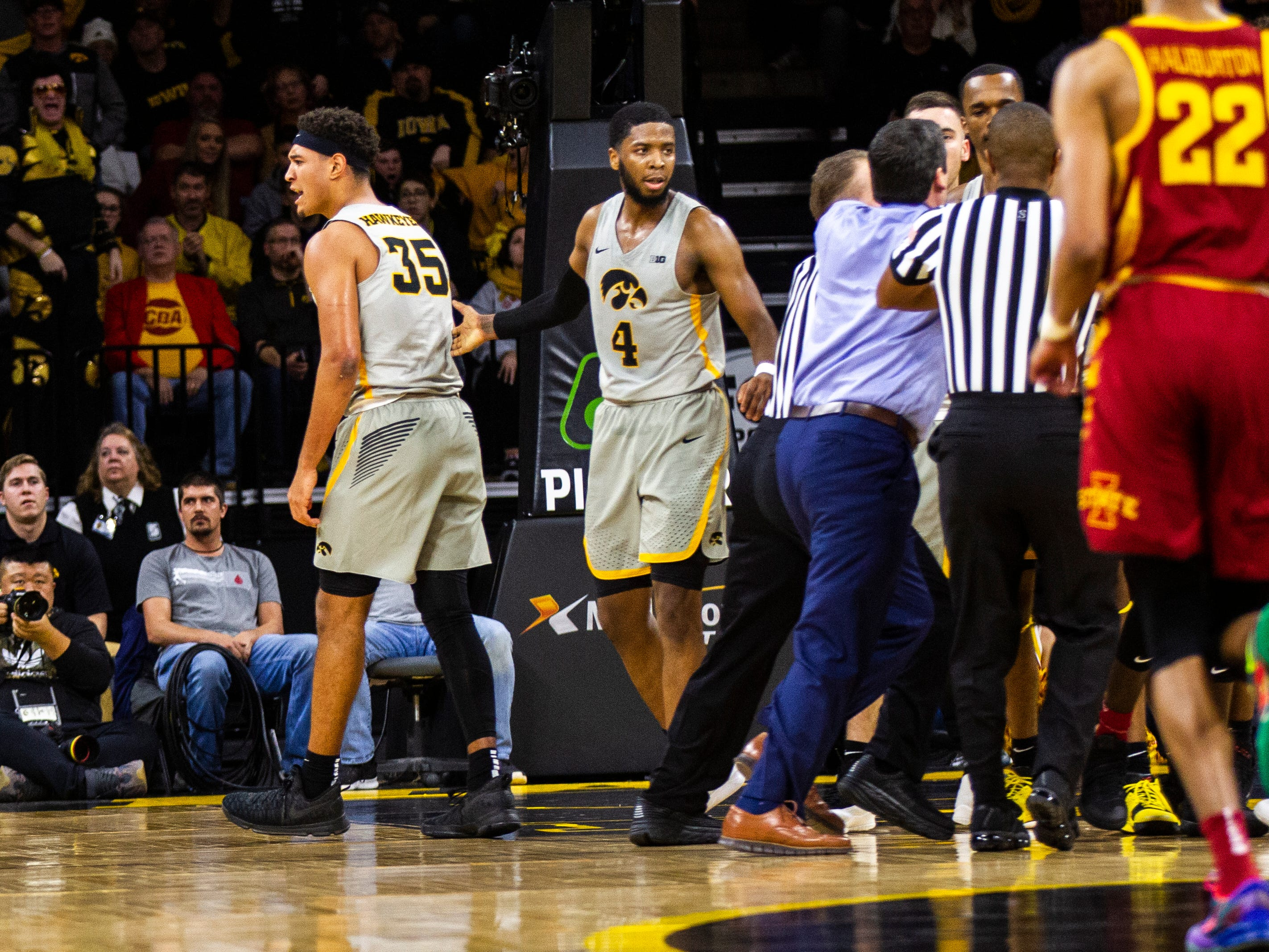 Iowa forward Cordell Pemsl (35) reacts while players get separated back to their benches while Iowa guard Isaiah Moss (4) looks on during a NCAA Cy-Hawk series men's basketball game on Thursday, Dec. 6, 2018, at Carver-Hawkeye Arena in Iowa City.