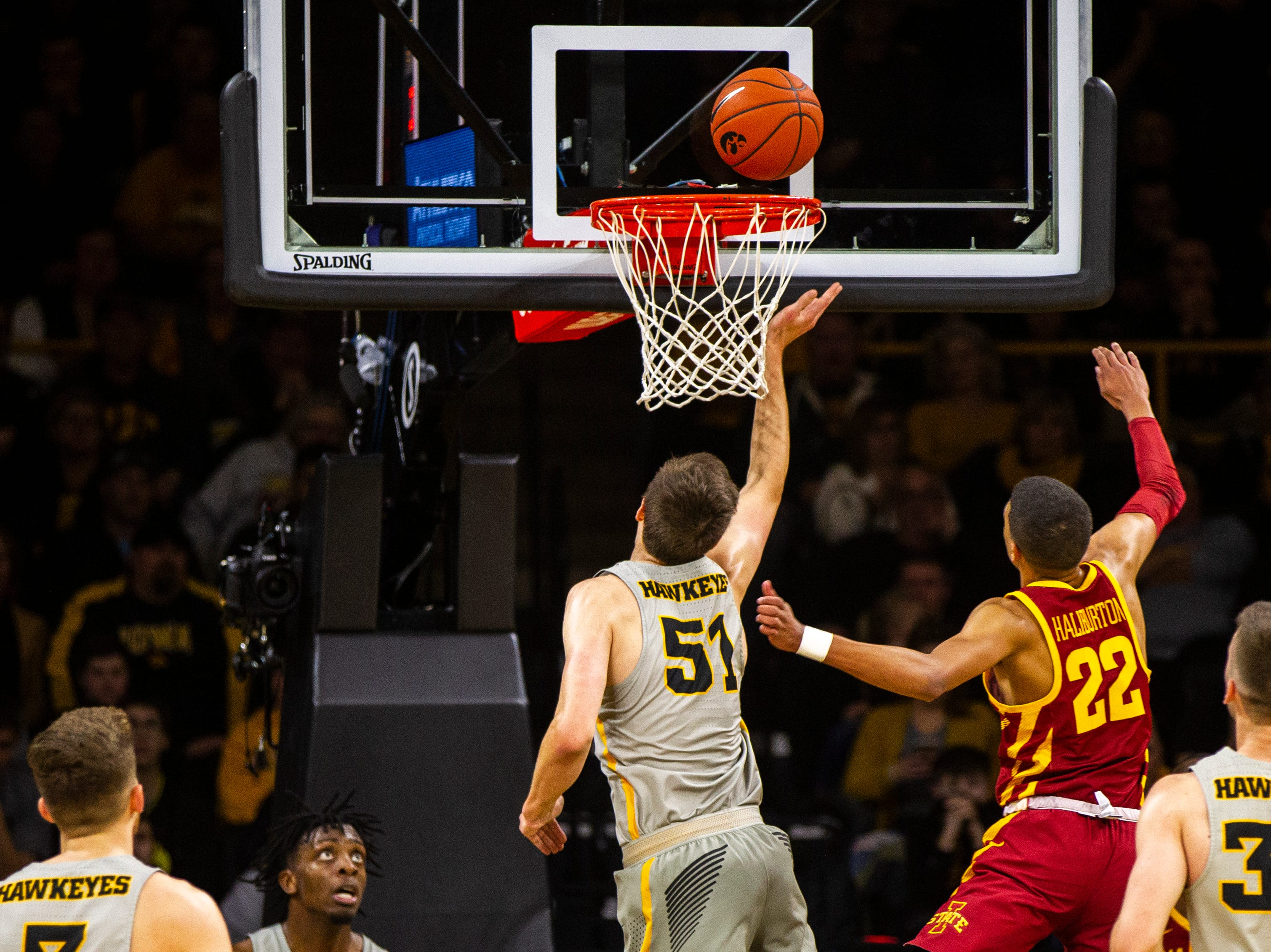 Iowa forward Nicholas Baer (51) tips a ball in during a NCAA Cy-Hawk series men's basketball game on Thursday, Dec. 6, 2018, at Carver-Hawkeye Arena in Iowa City.