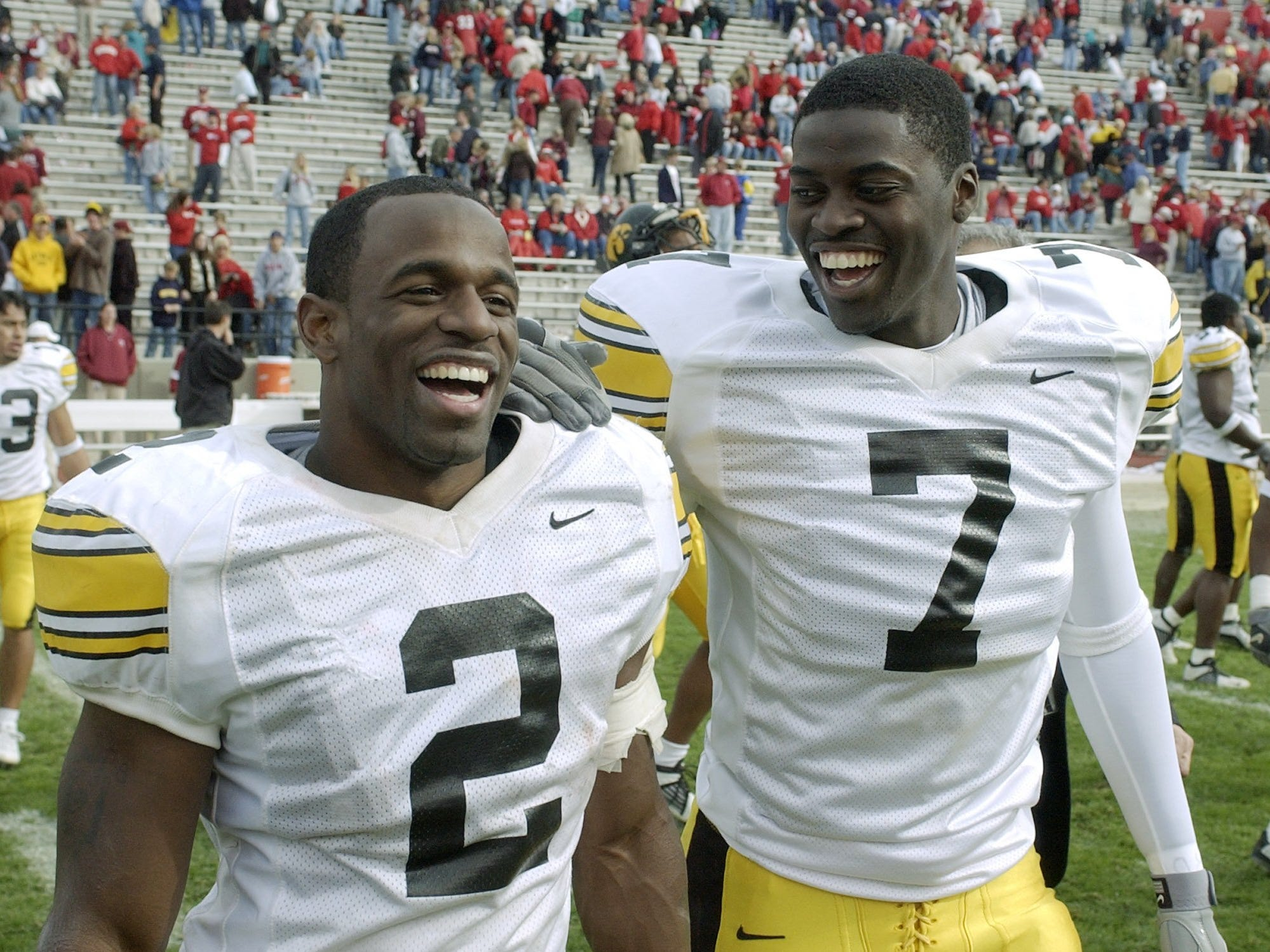 Iowa running back Fred Russell, left, jokes with quarterback Brad Banks after their 24-8 victory over Indiana in Bloomington, Indiana on Oct. 19, 2002. Russell had 100 yards rushing and two touchdowns. Banks passed for 190 yards and one touchdown.