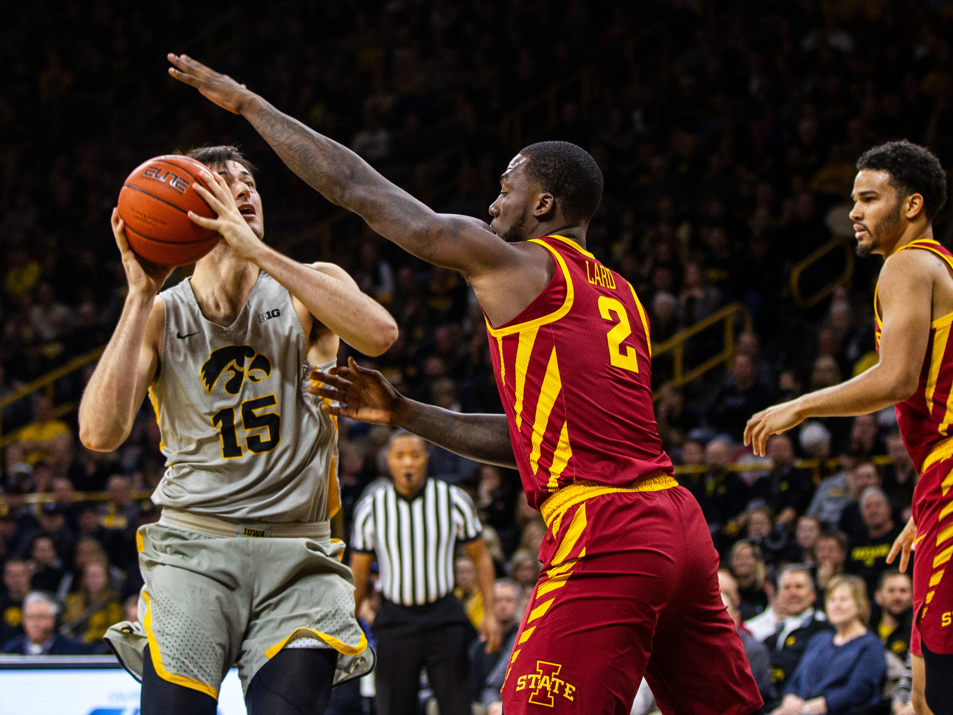 Iowa forward Ryan Kriener (15) attempts a basket while being defended by Iowa State forward Cameron Lard (2) during a NCAA Cy-Hawk series men's basketball game on Thursday, Dec. 6, 2018, at Carver-Hawkeye Arena in Iowa City.