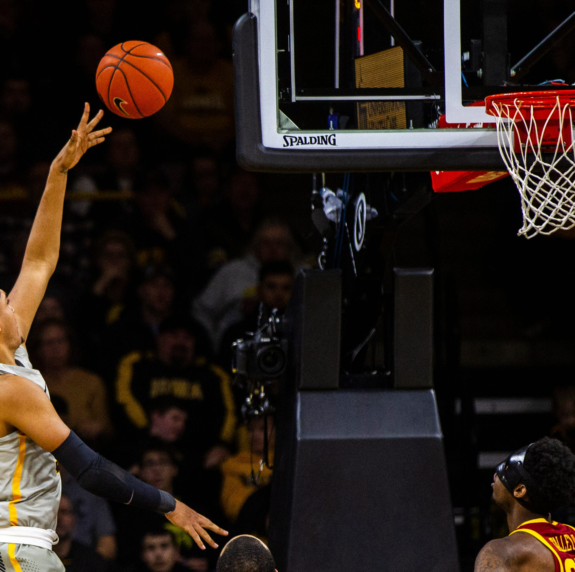 Iowa forward Cordell Pemsl (35) attempts a basket...