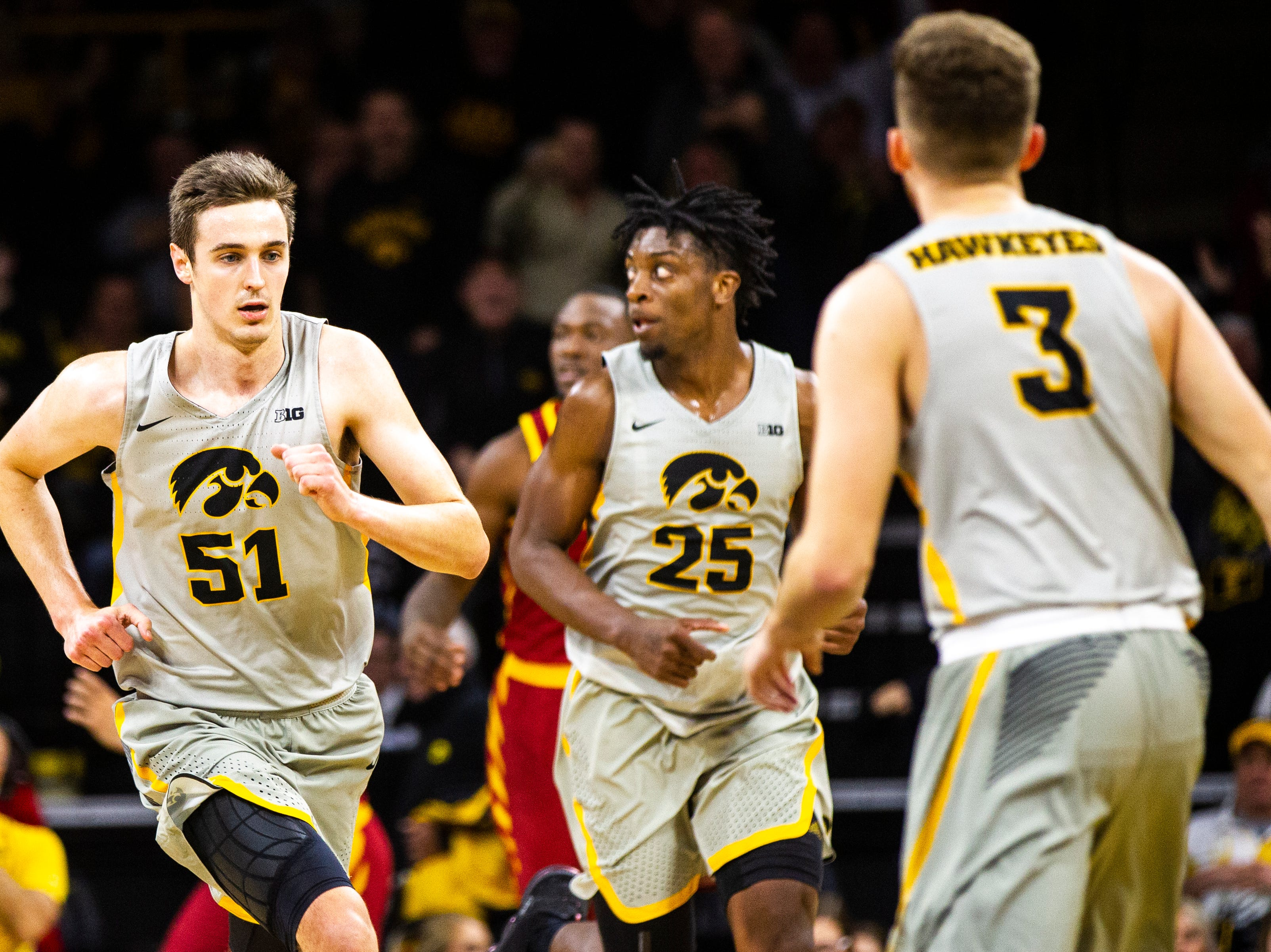 Iowa forward Nicholas Baer (51) runs up court after scoring during a NCAA Cy-Hawk series men's basketball game on Thursday, Dec. 6, 2018, at Carver-Hawkeye Arena in Iowa City.