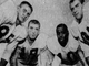 From 1956: Jim Gibbons, second from left, is tied for third all-time in touchdown catches by Iowa Hawkeyes tight ends with 11. From left, Hawkeyes center Don Suchy, Gibbons, end Frank Gilliam and guard Frank Bloomquist.