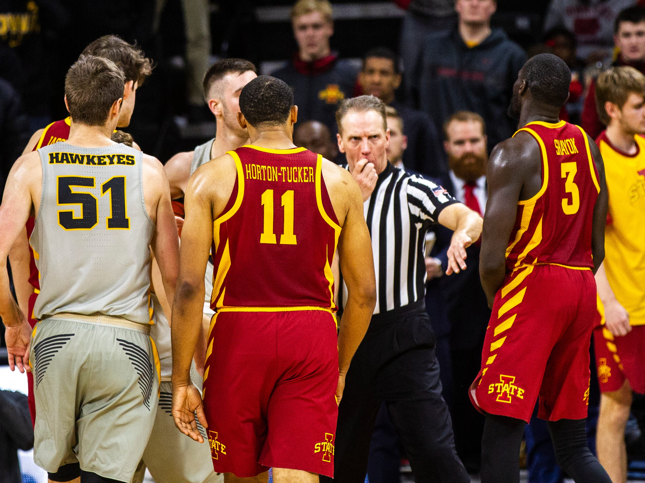 An official separates Iowa State guard Marial Shayok (3) from Iowa guard Connor McCaffery (30) at the buzzer after a NCAA Cy-Hawk series men's basketball game on Thursday, Dec. 6, 2018, at Carver-Hawkeye Arena in Iowa City.