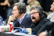 Gary Dolphin, right, has been suspended as Iowa's radio voice for the rest of the Iowa basketball season.