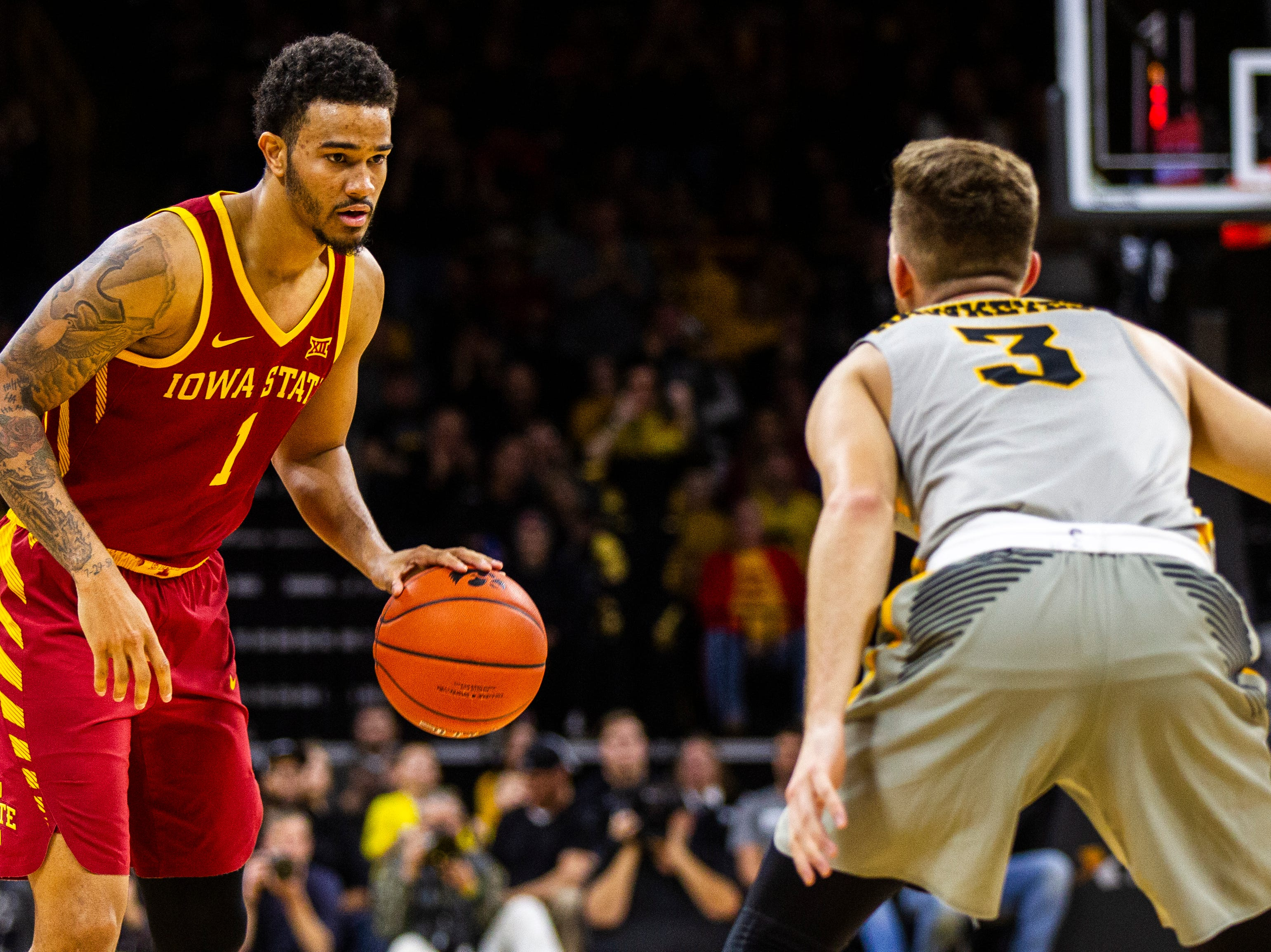 Iowa State guard Nick Weiler-Babb (1) gets defended by Iowa guard Jordan Bohannon (3) during a NCAA Cy-Hawk series men's basketball game on Thursday, Dec. 6, 2018, at Carver-Hawkeye Arena in Iowa City.