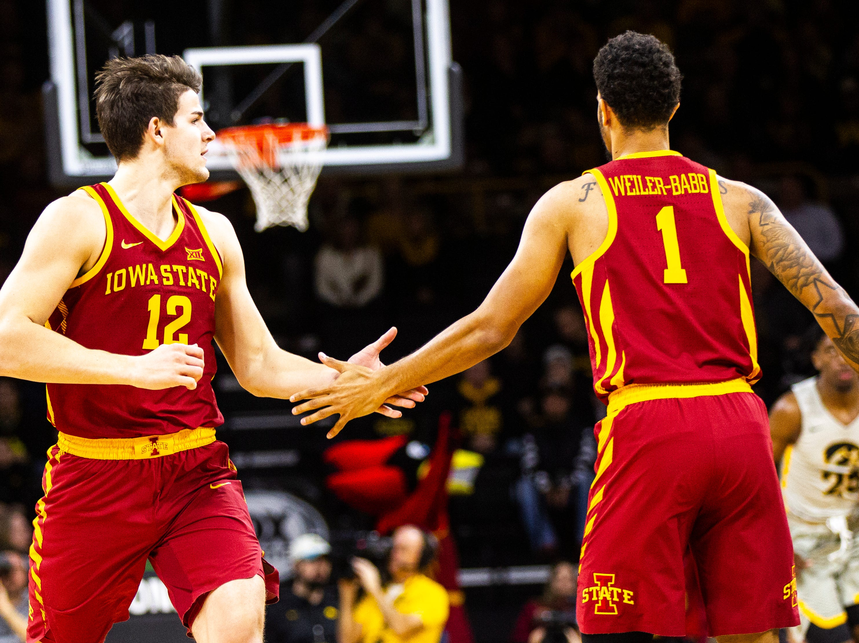 Iowa State forward Michael Jacobson (12) high-fives Iowa State guard Nick Weiler-Babb (1) during a NCAA Cy-Hawk series men's basketball game on Thursday, Dec. 6, 2018, at Carver-Hawkeye Arena in Iowa City.