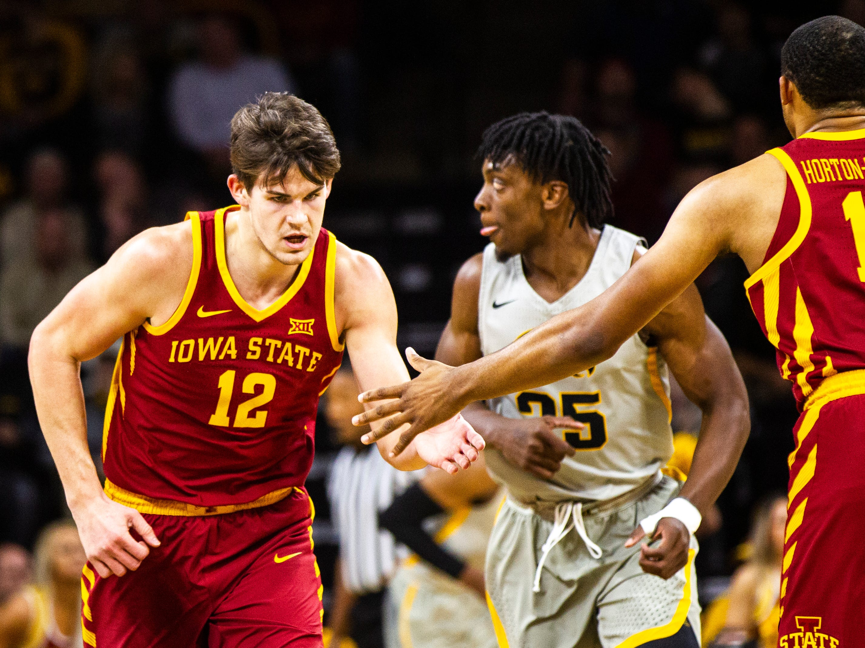 Iowa State forward Michael Jacobson (12) high-fives Iowa State guard Talen Horton-Tucker (11) during a NCAA Cy-Hawk series men's basketball game on Thursday, Dec. 6, 2018, at Carver-Hawkeye Arena in Iowa City.