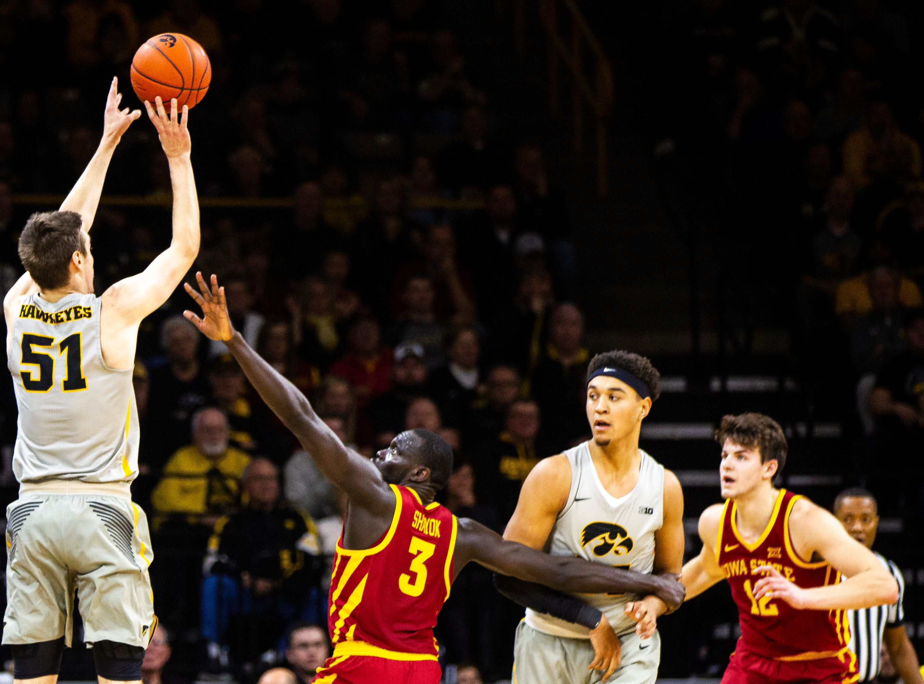 Iowa forward Nicholas Baer (51) shoots a 3-point basket past Iowa State guard Marial Shayok (3) during a NCAA Cy-Hawk series men's basketball game on Thursday, Dec. 6, 2018, at Carver-Hawkeye Arena in Iowa City.