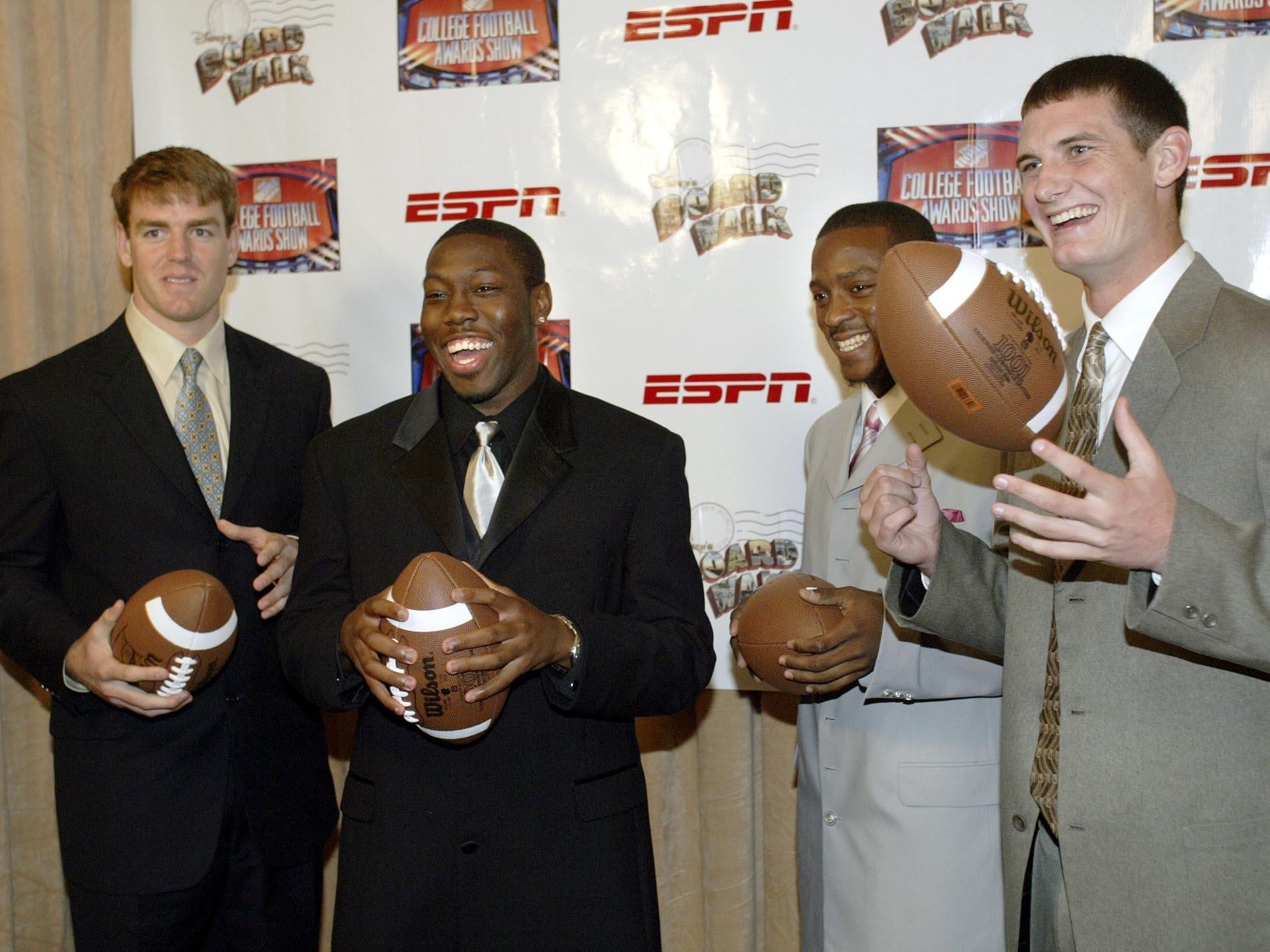 From 2002: From left, USC quarterback Carson Palmer, Iowa quarterback Brad Banks, Miami running back Willis McGahee and Miami quarterback Ken Dorsey post together at the 2002 Home Depot College Football Awards at the Atlantic Hall at the Walt Disney World Resort in Lake Buena Vista, Florida.