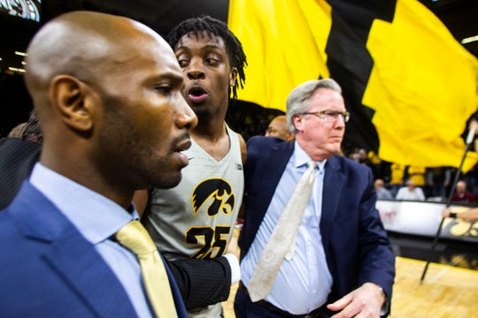 Iowa men's basketball head coach Fran McCaffery ushers Iowa forward Tyler Cook (25) off the court after a NCAA Cy-Hawk series men's basketball game on Thursday, Dec. 6, 2018, at Carver-Hawkeye Arena in Iowa City. The Hawkeyes defeated the Cyclones, 98-84.
