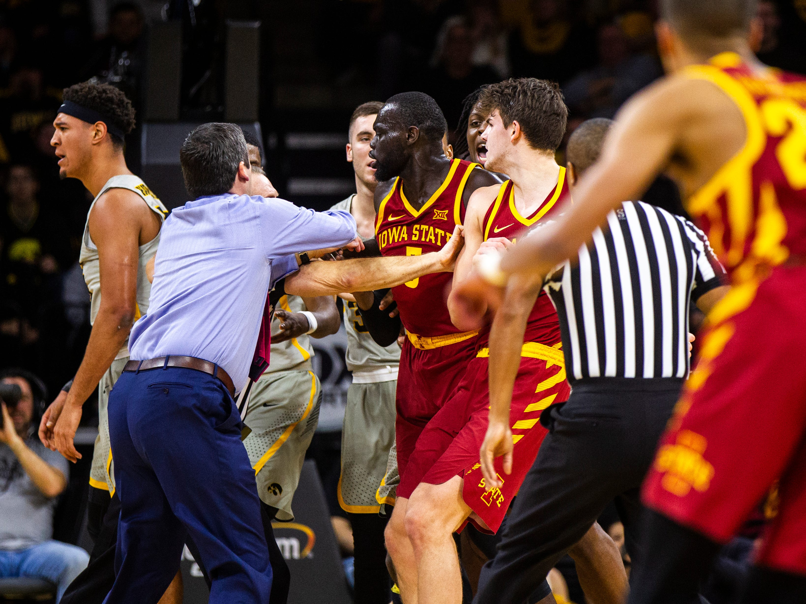 Iowa State head coach Steve Prohm and an official separate Iowa forward Cordell Pemsl (35) from Iowa State guard Marial Shayok (3) and Iowa State forward Michael Jacobson (12) during a NCAA Cy-Hawk series men's basketball game on Thursday, Dec. 6, 2018, at Carver-Hawkeye Arena in Iowa City.